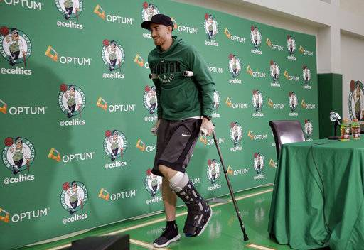 Boston Celtics' Gordon Hayward uses crutches as he steps away from a podium after taking questions from members of the media at an NBA basketball news conference, Thursday, Nov. 2, 2017 at the team's' training facility in Waltham, Mass. Hayward, who broke his ankle about 5 minutes into his NBA career opener at Cleveland on Oct. 17, says he knows he will not play again this season, after needing surgery to repair the injury. (AP Photo/Steven Senne)