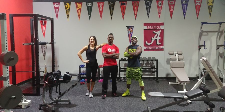 Tavares Chambliss, right, is pictured with BALL4Training co-owners Kasia and Todd Ball.