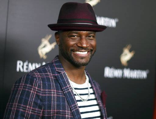 "FILE - In this June 15, 2017 file photo, Taye Diggs appears in West Hollywood, Calif. Diggs and Shane Evans will be promoting their picture book ""I Love You More� during the June 2-3 BookCon gathering at the Javits Center in Manhattan. (Photo by Richard Shotwell/Invision/AP, File)"