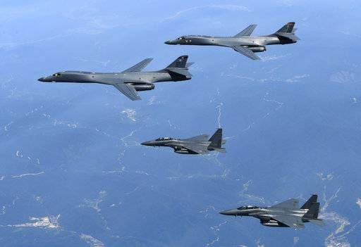 FILE - In this June 20, 2017 file photo provided by South Korean Defense Ministry, U.S. Air Force B-1B bombers, top, and second from top, and South Korean fighter jets F-15K fly over the Korean Peninsula, South Korea. A South Korean military official said Friday, Nov. 3, 2017, the B-1B bombers based in Guam were escorted by two South Korean F-16 fighter jets during the drills Thursday at a field near the South's eastern coast. The drills simulated attacks on land targets, but didn't involve live weapons, said the official, who did not want to be named, citing office rules. (South Korean Defense Ministry via AP, File)
