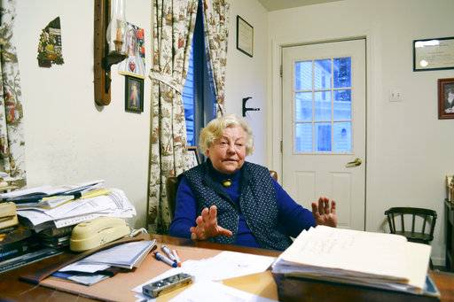 Dr. Anna Konopka sits in her tiny office, Thursday, Nov. 2, 2017 in New London, N.H.. The 84-year-old physician is fighting to get her license back after being accused by the state's Board of Medicine of problems with her record keeping, prescribing of medicines and medical decision making. Among the problems is that she doesn't use a computer so can't participate in the state-regulated drug monitoring program. (AP Photo/Michael Casey)