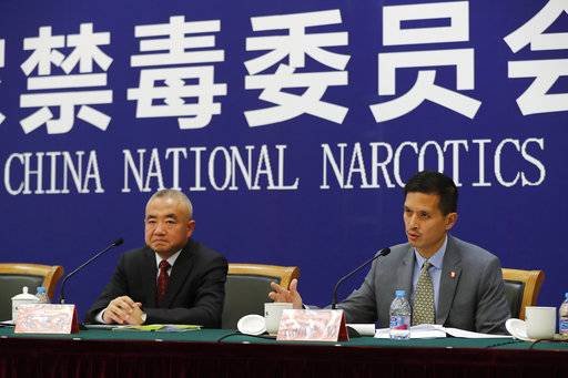 U.S. Drug Enforcement Administration's representative in Beijing, Lance Ho, right, speaks next to Wei Xiaojun, deputy director-general of the Narcotics Control Bureau of the Ministry of Public Security during a press conference at a hotel in Beijing, Friday, Nov. 3, 2017. Wei disputed President Donald Trump's claim that the opioid flooding the U.S. is mostly produced in China. (AP Photo/Andy Wong)