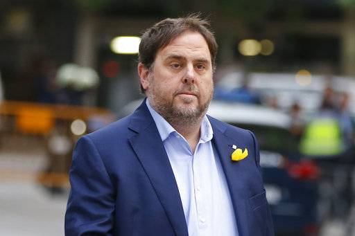 Former Catalan Vice President Oriol Junqueras arrives at the National Court for questioning by a National Court judge investigating possible rebellion charges, in Madrid, Spain, Thursday Nov. 2, 2017. A National Court judge has ordered nine ex-members of the sacked Catalan government to jail including Junqueras and set bail for one after quizzing them on possible charges of rebellion, sedition and embezzlement. (AP Photo/Paul White)