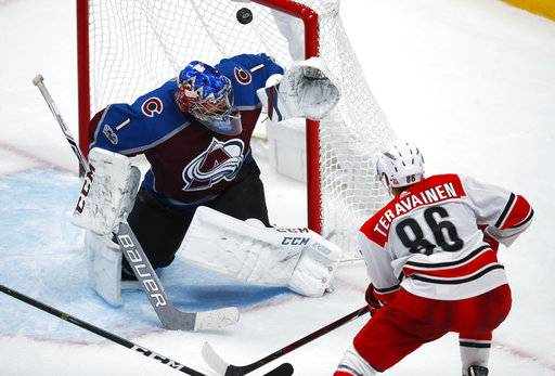 Colorado Avalanche goalie Semyon Varlamov, left, of Russia, deflects a shot by Carolina Hurricanes left wing Teuvo Teravainen, of Finland, during the third period of an NHL hockey game Thursday, Nov. 2, 2017, in Denver. Colorado won 5-3. (AP Photo/David Zalubowski)