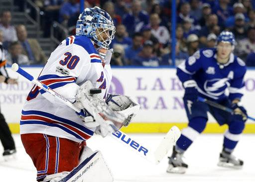 New York Rangers goalie Henrik Lundqvist (30), of Sweden, makes a blocker save on a shot by the Tampa Bay Lightning during the second period of an NHL hockey game Thursday, Nov. 2, 2017, in Tampa, Fla. (AP Photo/Chris O'Meara)
