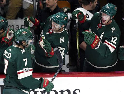 Minnesota Wild's Nino Niederreiter (22), of Switzerland, and Eric Staal (12) congratulate center Matt Cullen (7) on a goal against the Montreal Canadiens during the first period of an NHL hockey game Thursday, Nov. 2, 2017, in St. Paul, Minn. (AP Photo/Hannah Foslien)