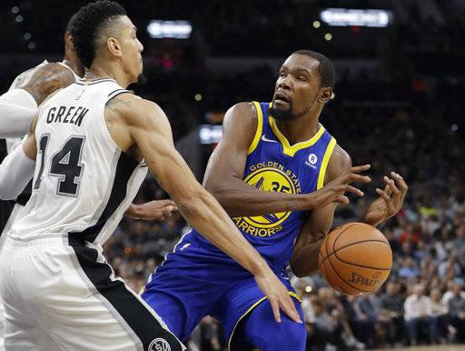 San Antonio Spurs guard Danny Green (14) knocks the ball away from Golden State Warriors forward Kevin Durant (35) during the first half of an NBA basketball game, Thursday, Nov. 2, 2017, in San Antonio. (AP Photo/Eric Gay)