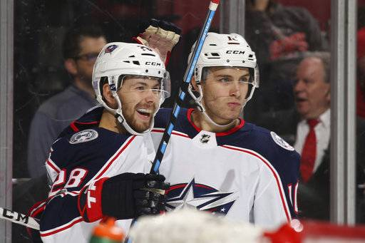 Columbus Blue Jackets right wing Oliver Bjorkstrand (28) celebrates his goal with Columbus Blue Jackets center Alexander Wennberg (10) during the second period of an NHL hockey game against the Florida Panthers, Thursday, Nov. 2, 2017, in Sunrise, Fla. (AP Photo/Joel Auerbach)