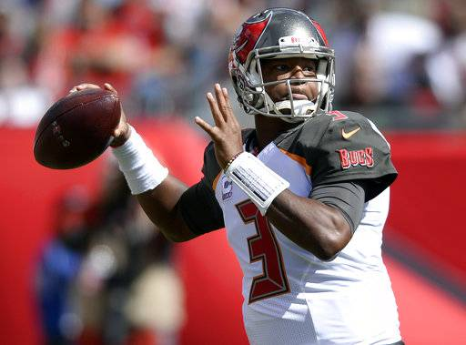 FILE - In this Sunday, Oct. 29, 2017, file photo, Tampa Bay Buccaneers quarterback Jameis Winston throws a pass during the second quarter of an NFL football game in Tampa, Fla. Winston is throwing early in a week for the first time since injuring his right shoulder, and the Buccaneers hope that will be beneficial against the New Orleans Saints. (AP Photo/Jason Behnken, File)