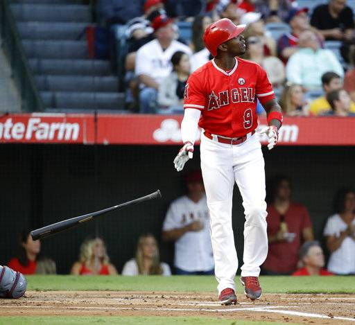 FILE - In this Sept. 16, 2017, file photo, Los Angeles Angels' Justin Upton watches his home run against the Texas Rangers during the first inning of a baseball game, in Anaheim, Calif. Outfielder Justin Upton is staying with the Angels, agreeing to a new five-year, $106 million contract. The Angels announced the deal Thursday, Nov. 2, 2017, with Upton, their late-season trade acquisition. (AP Photo/Chris Carlson, File)