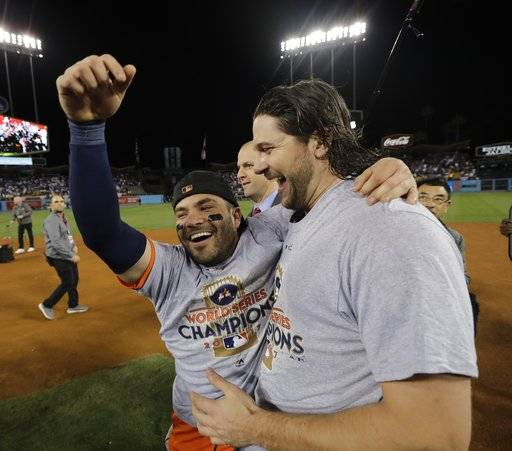 Houston Astros' Jose Altuve and Jake Marisnick celebrate after Game 7 of baseball's World Series against the Los Angeles Dodgers Wednesday, Nov. 1, 2017, in Los Angeles. The Astros won 5-1 to win the series 4-3. (AP Photo/David J. Phillip)
