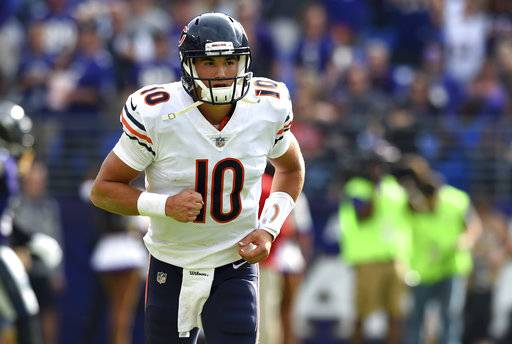 FILE - In this Sunday, Oct. 15, 2017, file photo, Chicago Bears quarterback Mitchell Trubisky runs on the field in the second half of an NFL football game against the Baltimore Ravens in Baltimore. Trubisky and the Bears hit their bye and the midway point of the season showing signs of hope. At 3-5, Chicago has matched its win total from last year's 3-13 nightmare. (AP Photo/Gail Burton, File)