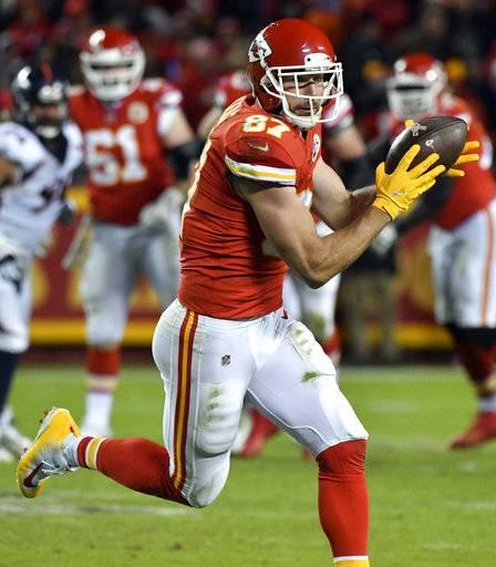 Kansas City Chiefs tight end Travis Kelce (87) makes a catch during the second half of an NFL football game against the Denver Broncos in Kansas City, Mo., Monday, Oct. 30, 2017. (AP Photo/Ed Zurga)
