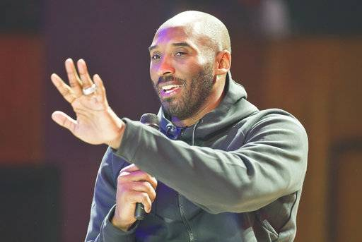 Former NBA star Kobe Bryant gestures as he speaks to invited guests during an event to inaugurate new Basketball play ground in Paris, France, Saturday, Oct. 21, 2017. Kobe Bryant said to Sports News Television that he wouldn't go to the White House if President Donald Trump invited him. (AP Photo/Michel Euler)