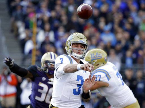 UCLA quarterback Josh Rosen (3) throws against Washington in the first half of an NCAA college football game Saturday, Oct. 28, 2017, in Seattle. (AP Photo/Elaine Thompson)