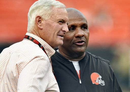 FILE - In this Aug. 21, 2017, file photo, Cleveland Browns owner Jimmy Haslam, left, talks with head coach Hue Jackson before an NFL preseason football game between the New York Giants in Cleveland. For the second straight year they've reached the midway point of the season at 0-8. They're now 1-23 under coach Hue Jackson and an analytics-reliant front office, whose decision to tear a roster down to its foundation has proven not only to be a failure but foolish. (AP Photo/David Richard, File)