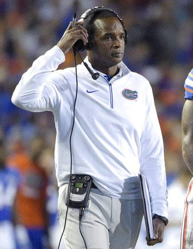 FILE - In this Nov. 28, 2015, file photo, Florida associate head coach Randy Shannon walks onto the field during a timeout in the first half of an NCAA college football game against Florida State in Gainesville, Fla. Shannon, the new interim Florida coach, says he learned plenty from getting fired by his alma mater, and knows the next four weeks with the Gators will be proving ground for him, his staff and his team. (AP Photo/Phelan M. Ebenhack, File)
