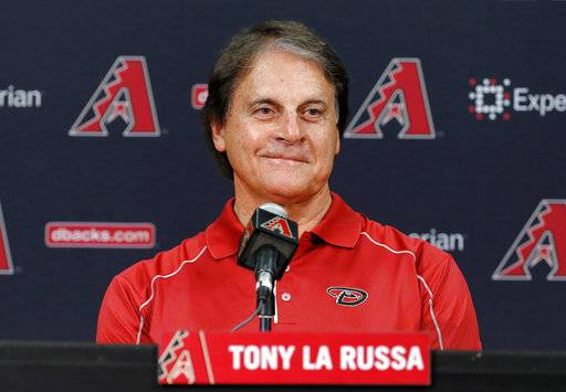 FILE - In this May 17, 2014, file photo, Tony La Russa, newly hired as chief baseball officer for the Arizona Diamondbacks, speaks to reporters after being introduced in Phoenix. The Boston Red Sox have hired La Russa to serve as a vice president and special assistant on its baseball operations staff, the announced Thursday, Nov. 2, 2017. He served the past four seasons as the Arizona Diamondbacks chief baseball analyst, advising Arizona's baseball operations department. (AP Photo/Matt York, File)