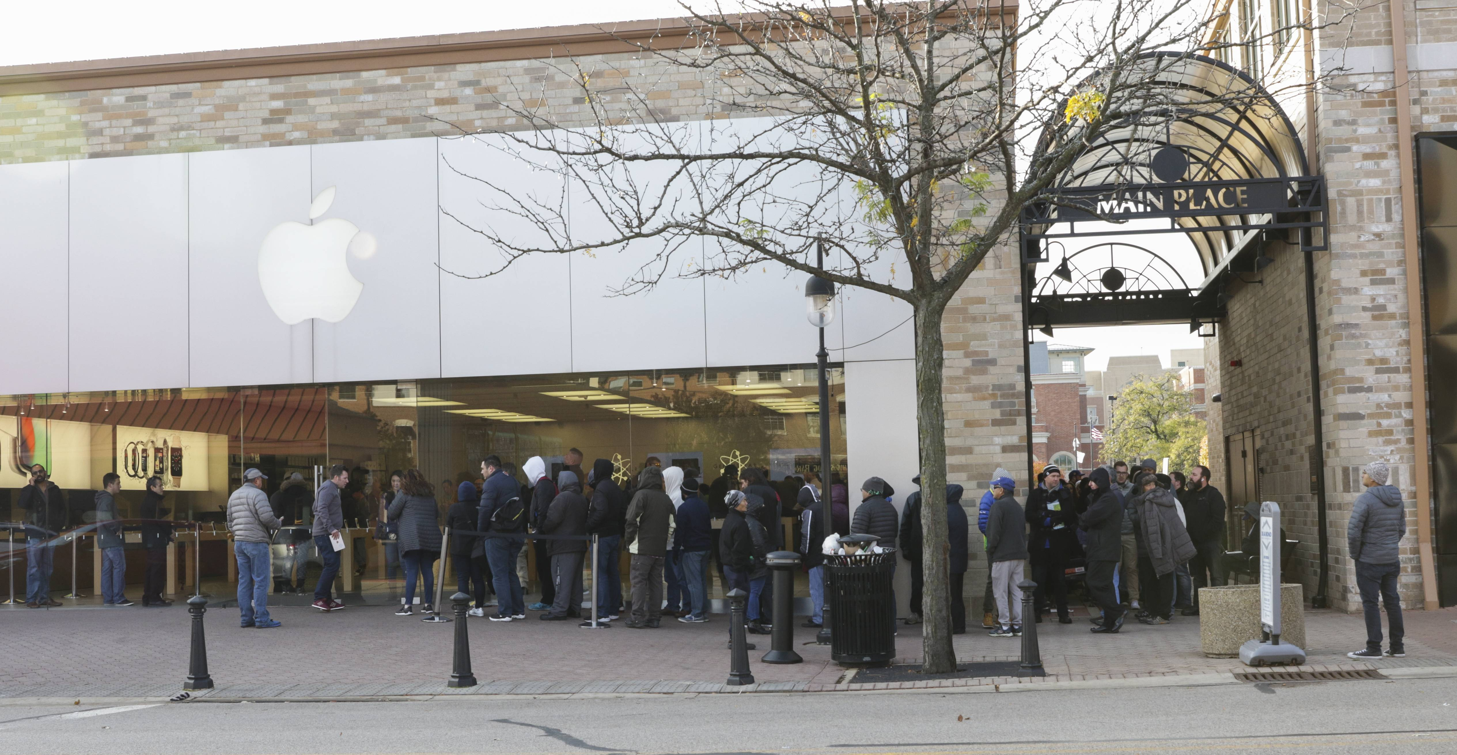 People line up for the new iPhone X Friday at the Apple store in Naperville.