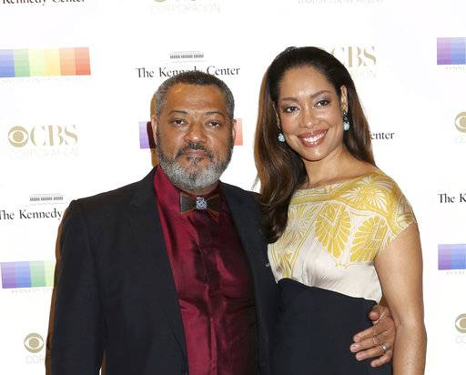 FILE - In this Dec. 6, 2015 file photo, Laurence Fishburne, left, and Gina Torres attend the 38th Annual Kennedy Center Honors at The Kennedy Center Hall of States in Washington. Court records in Los Angeles show that Fishburne filed for divorce from his wife of 15 years, Torres, on Thursday, Nov. 2, 2017, and is seeking joint custody of their 10-year-old daughter. (Photo by Greg Allen/Invision/AP, File)
