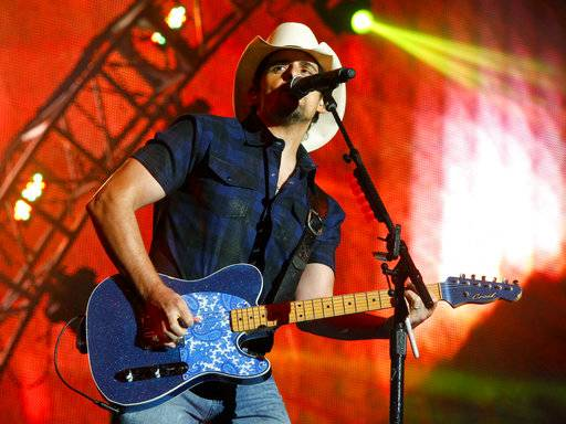 Brad Paisley, the co-host of the Country Music Association Awards, is calling on the organization to rescind media restrictions barring reporters from asking about the mass shooting in Las Vegas, gun rights or political affiliations at the awards show.