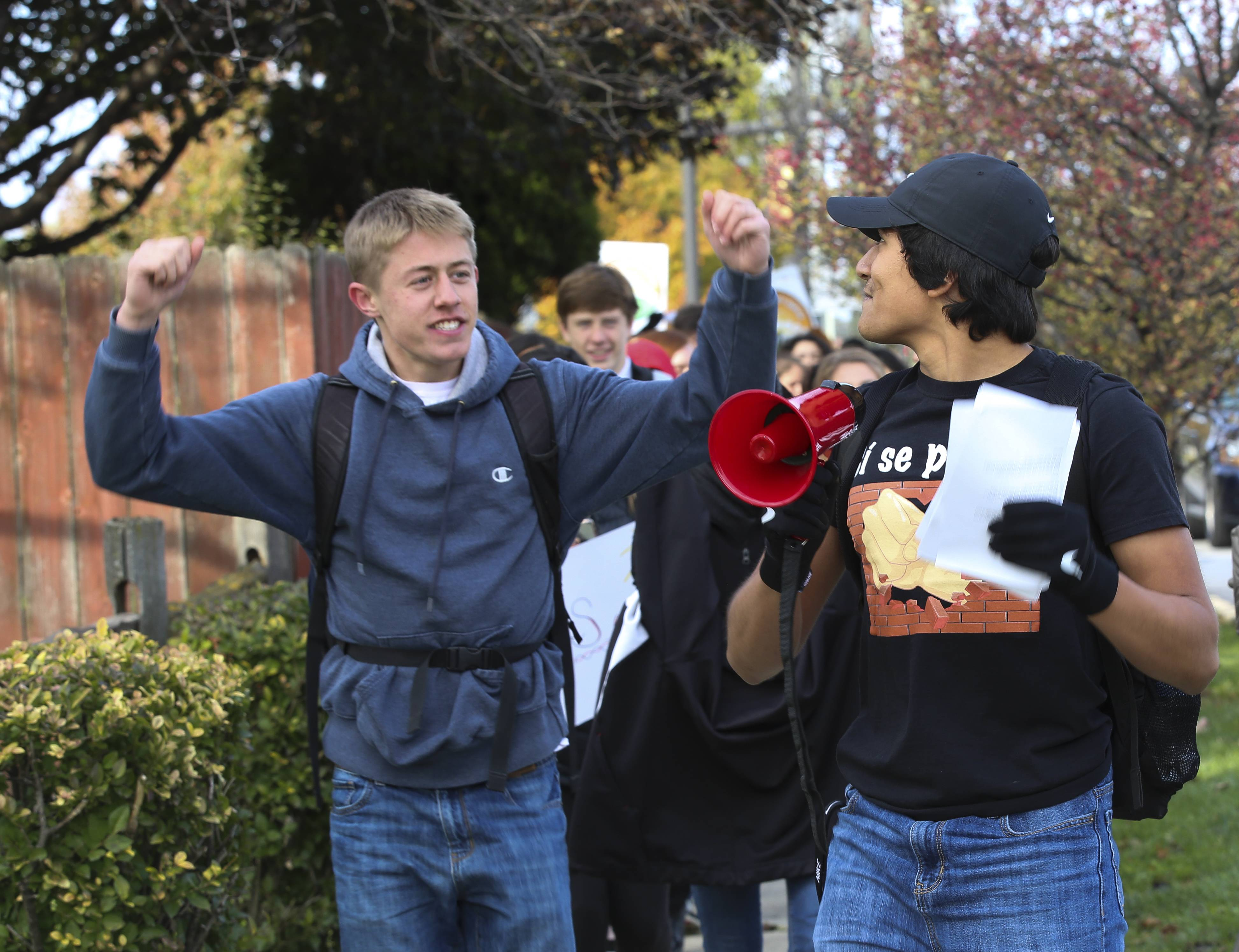 Jimmy Lynch, left, a senior at Glenbard East, says he organized a Friday march to call attention to the Deferred Action for Childhood Arrivals program. He said the program should be made permanent.