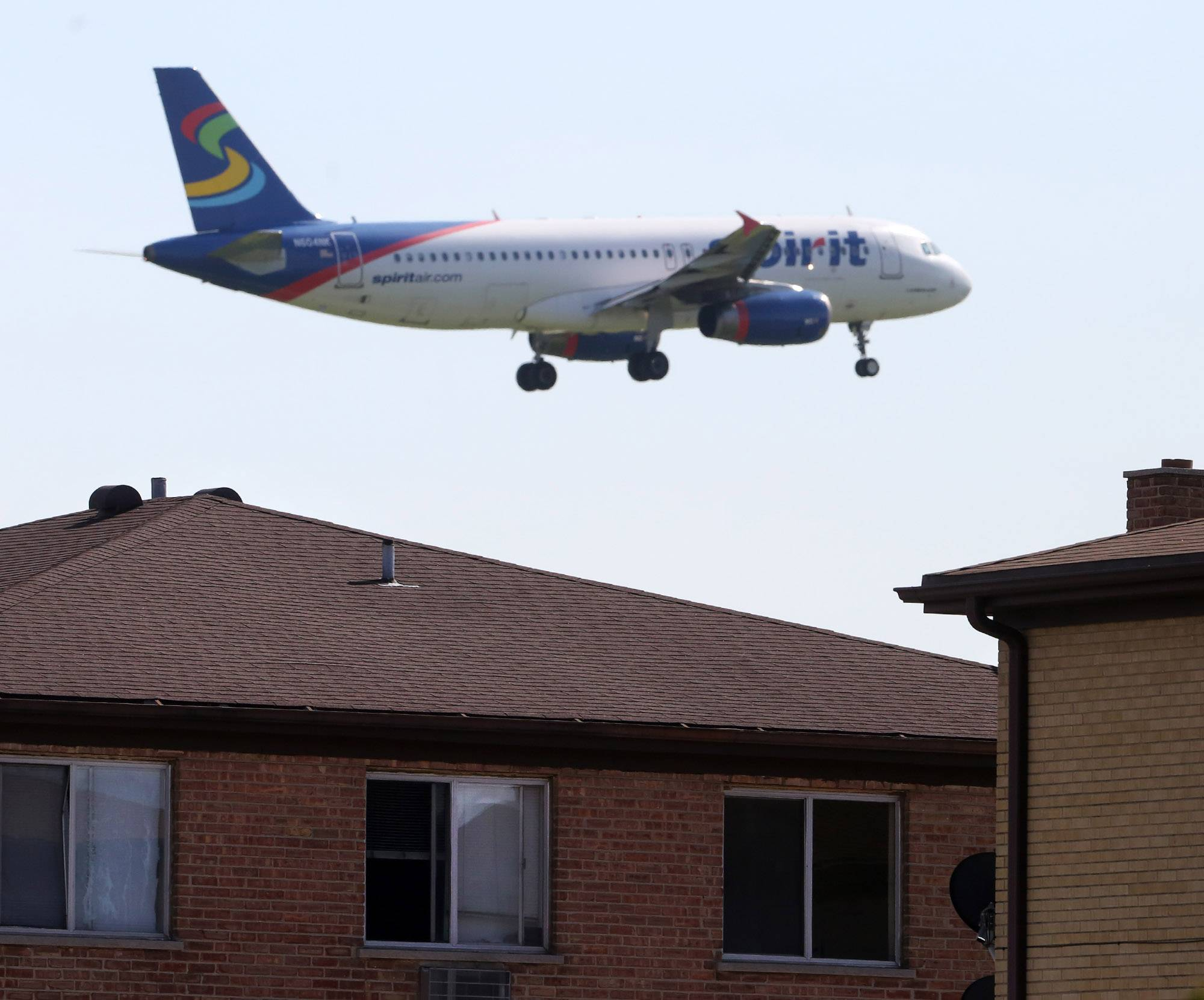 A jet flies over apartments near Allstate Arena in Rosemont.