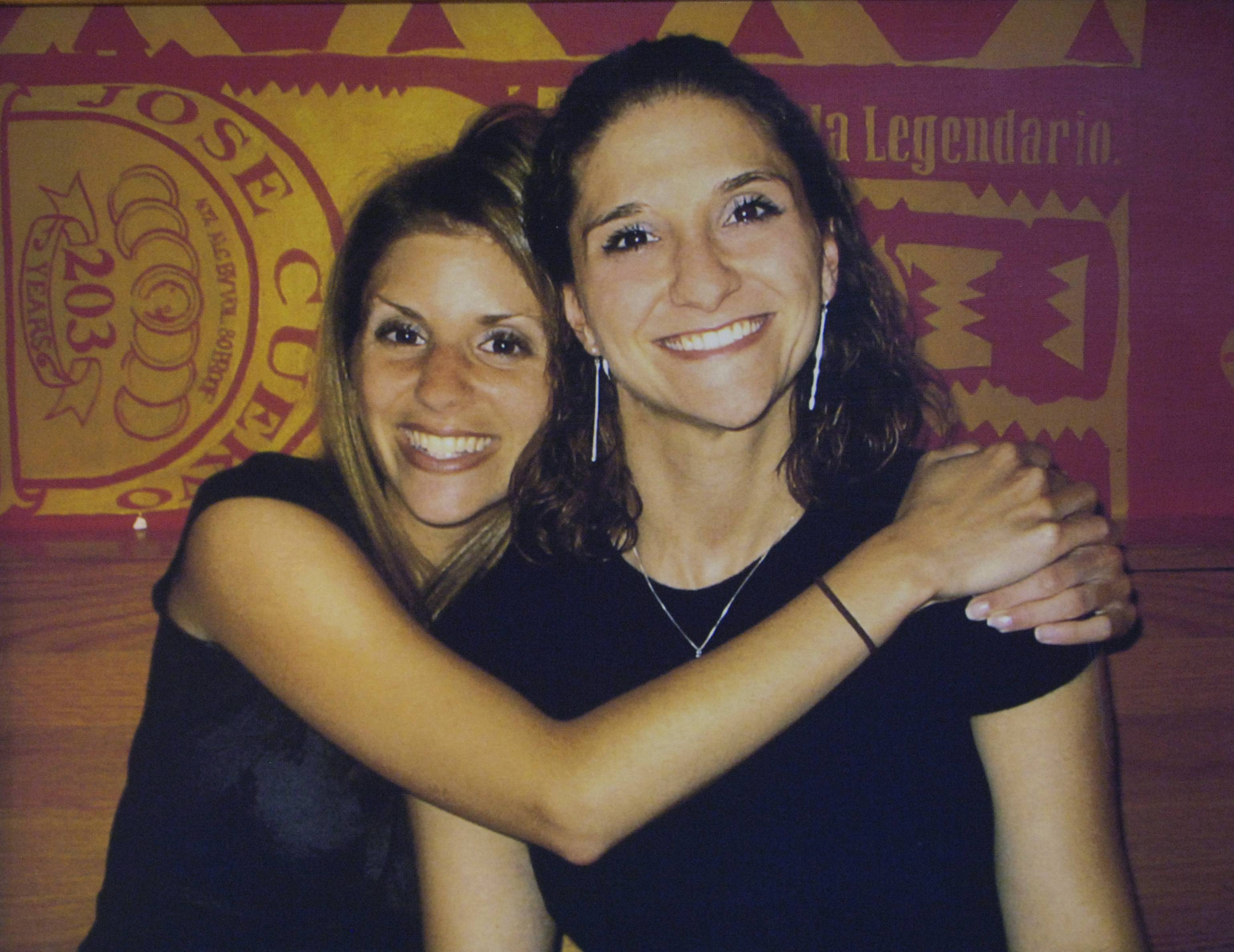 Sarah Mangi, left, with her sister, Dana, who was killed in 2007.