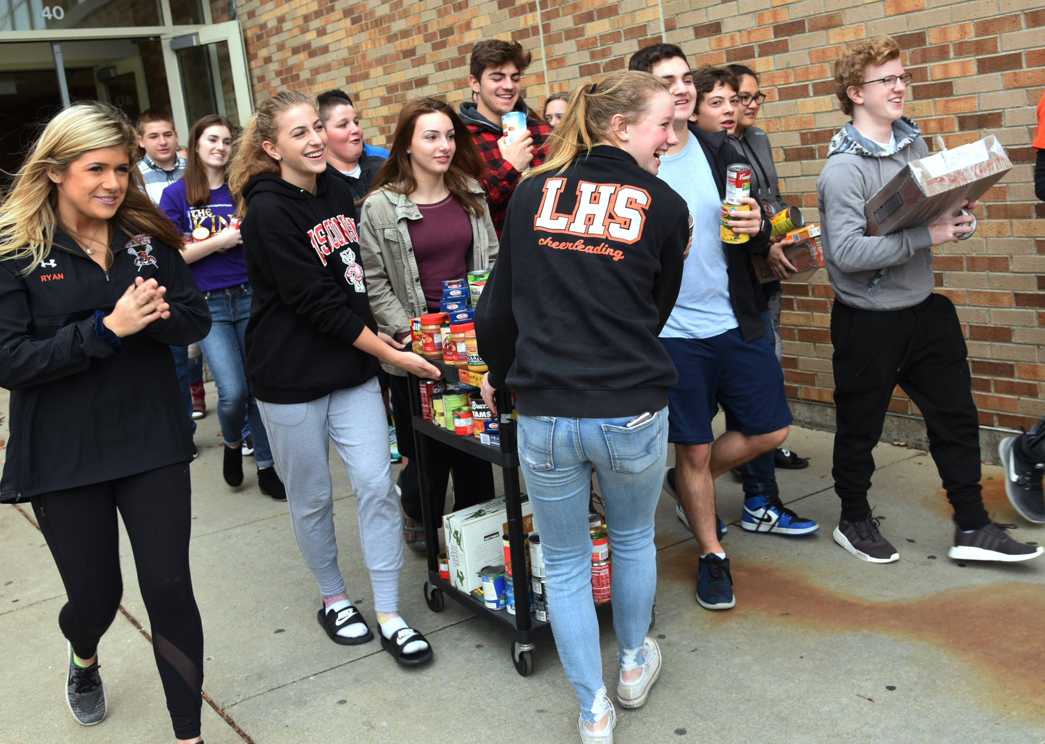 Libertyville High School and the Student Council held a canned food drive for the Libertyville Township food pantry. On Friday, students moved the items to township trucks to be delivered to the pantry.
