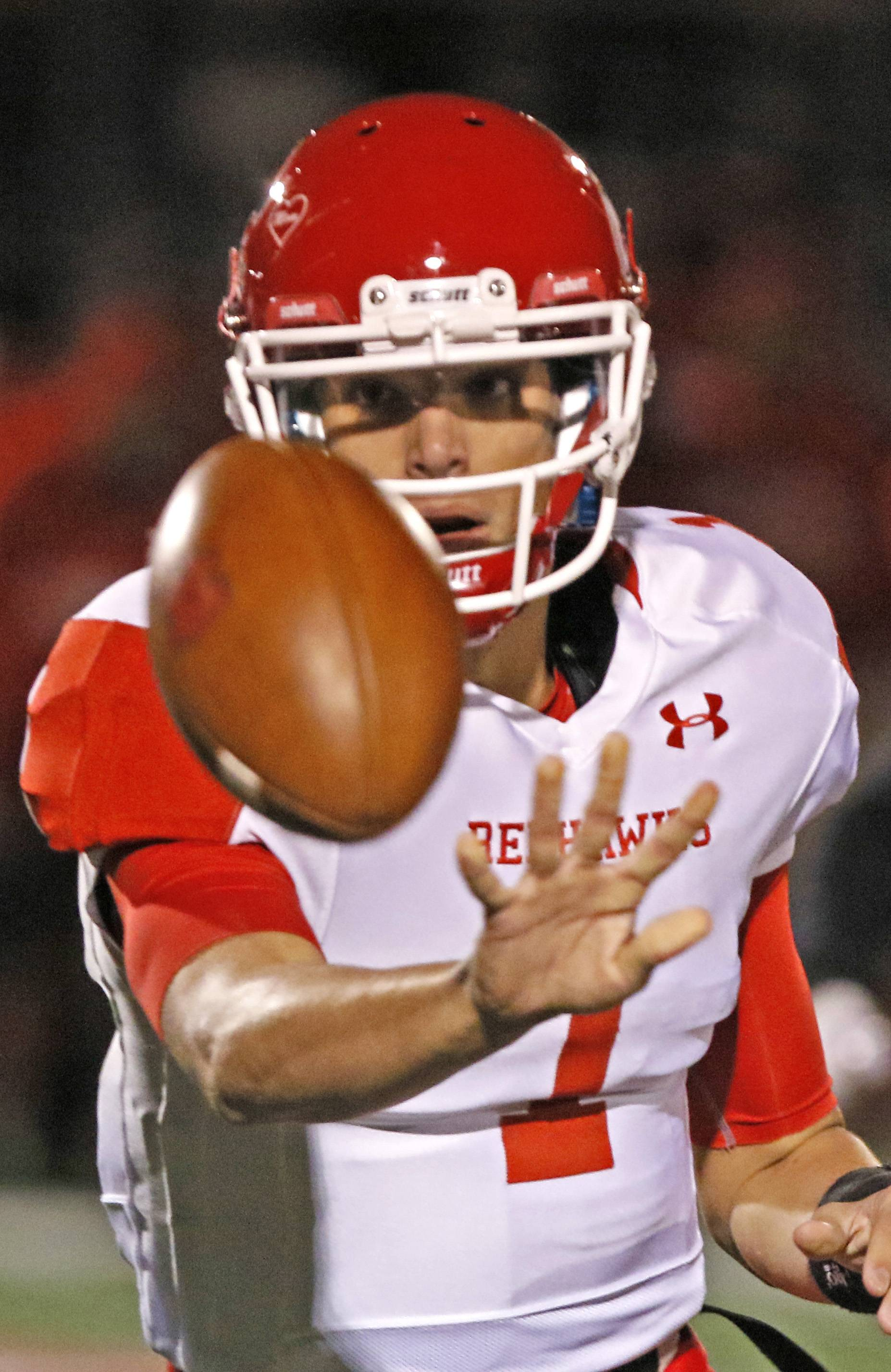 Naperville Central quarterback Payton Thorne throws to an outside receiver against Homewood Flossmoor during second round Class 8A football playoffs.