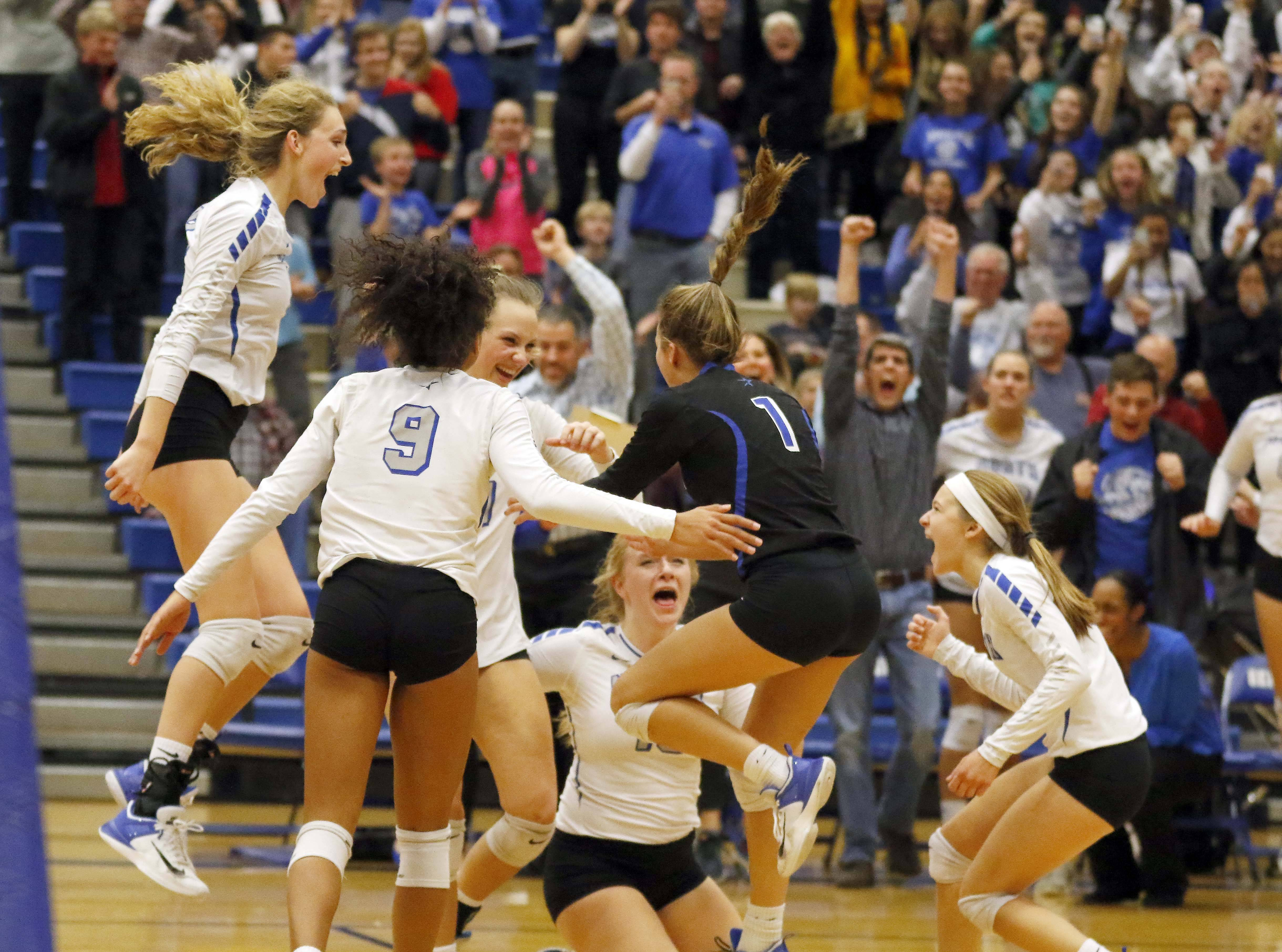 St. Charles North celebrates defeating Downers Grove North Friday in the Class 4A Geneva supersectional.