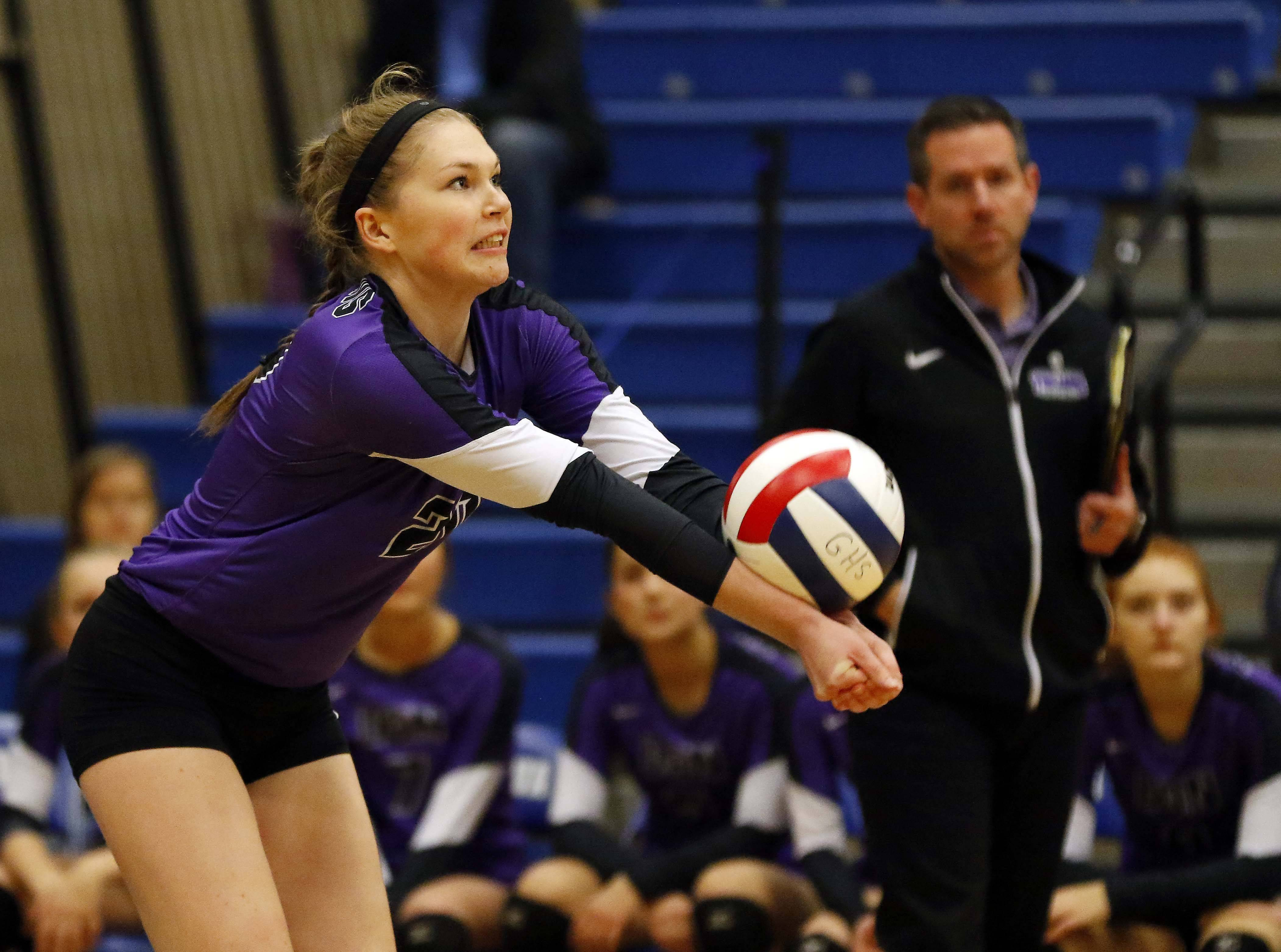 Downers Grove North's Clare Delaplane (20) returns a hit during the Girls volleyball Friday in the Geneva volleyball supersectional.