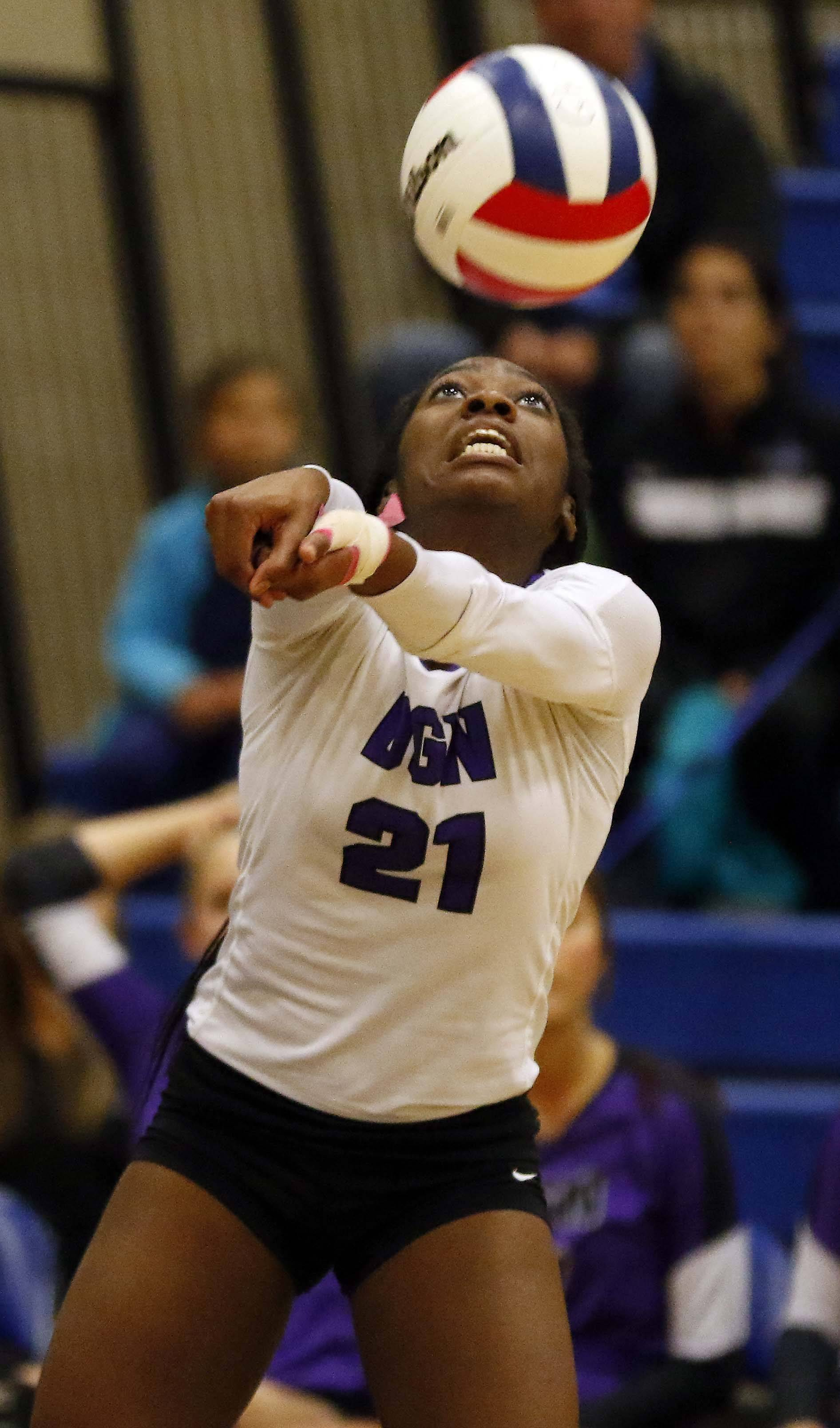 Downers Grove North's Kessie Olekanma (21) Friday in the Geneva volleyball supersectional.