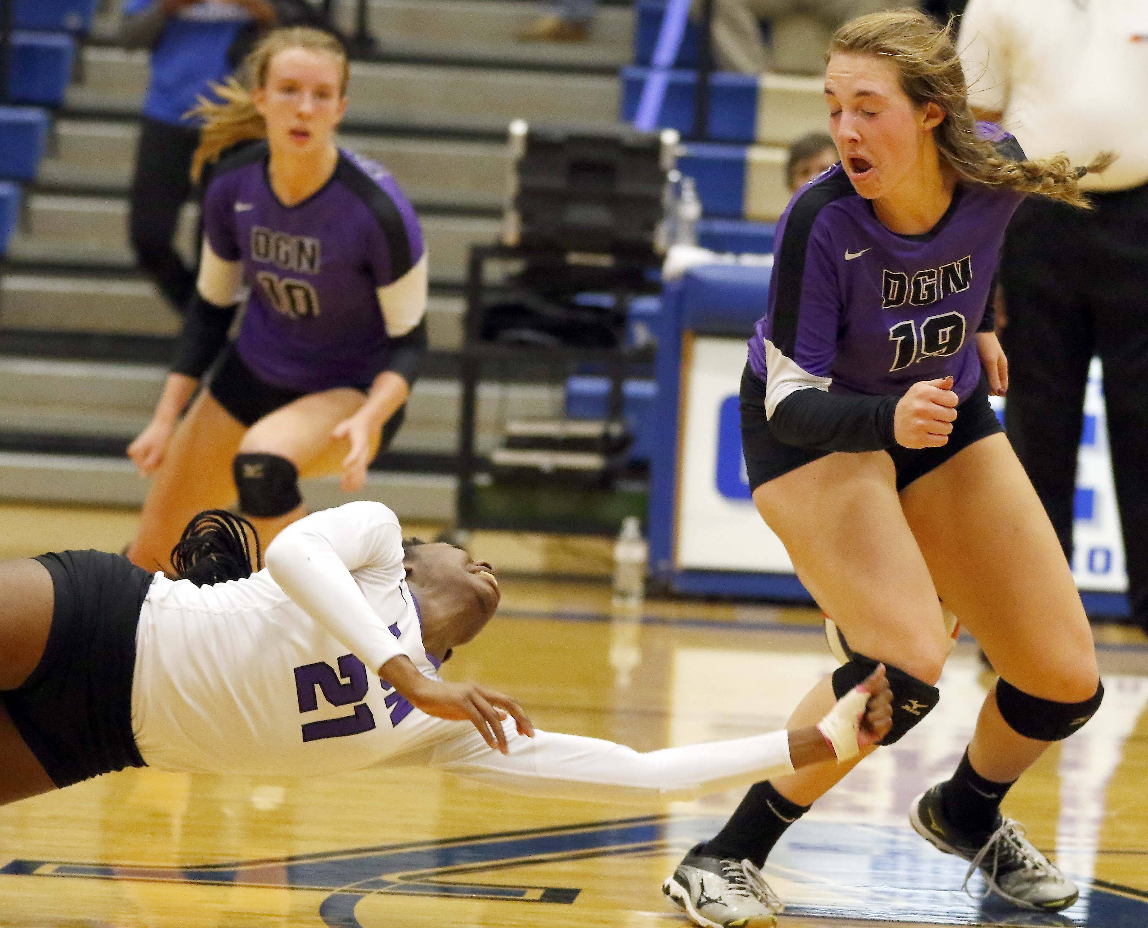 Downers Grove North's Kessie Olekanma (21) can't quite get the dig late in the match Friday in the Geneva volleyball supersectional.