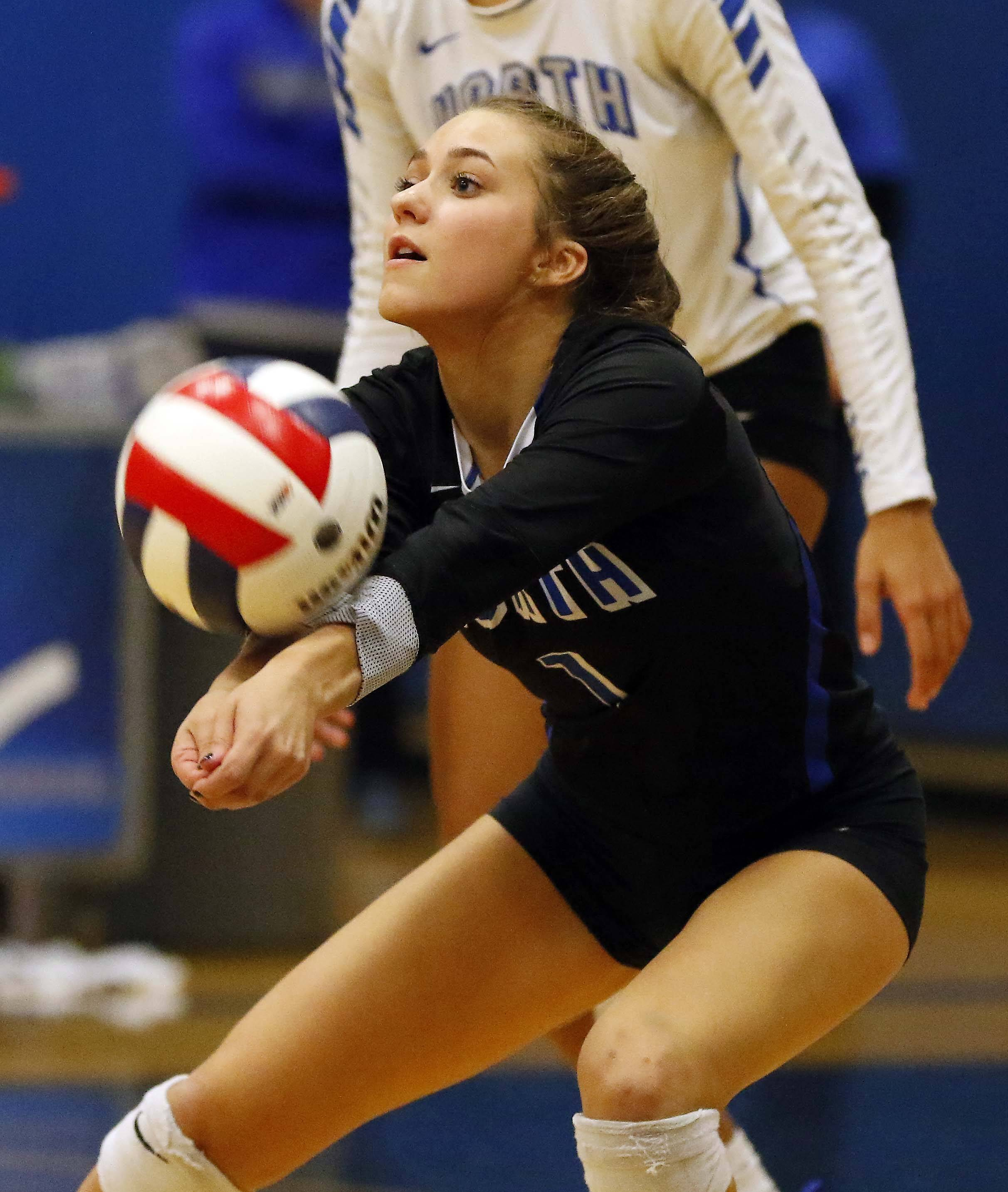 St. Charles North's Lauren Caprini (1) Friday in the Geneva volleyball supersectional.