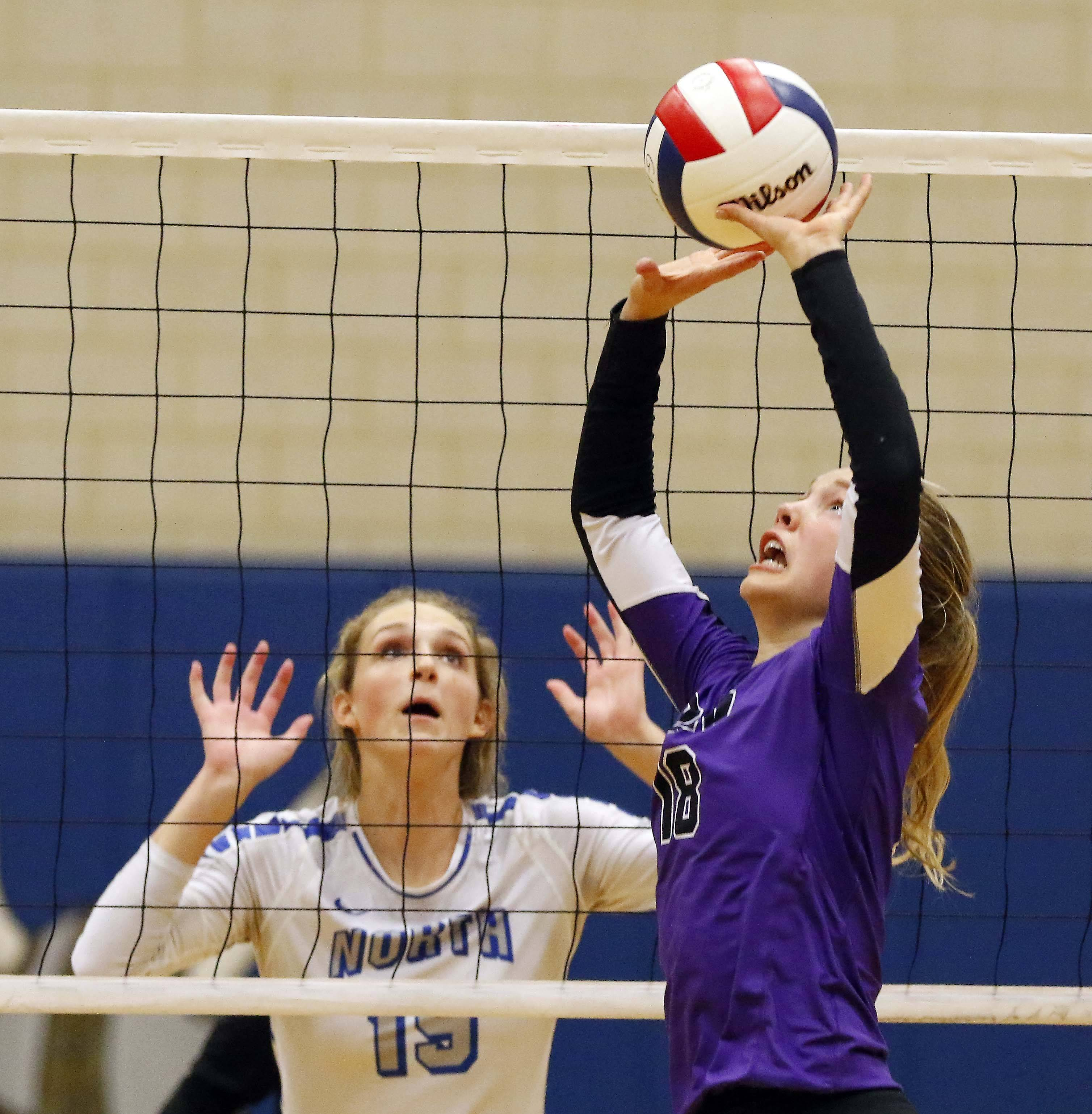 Downers Grove North's Elizabeth Dunlap (18) Friday in the Geneva volleyball supersectional.