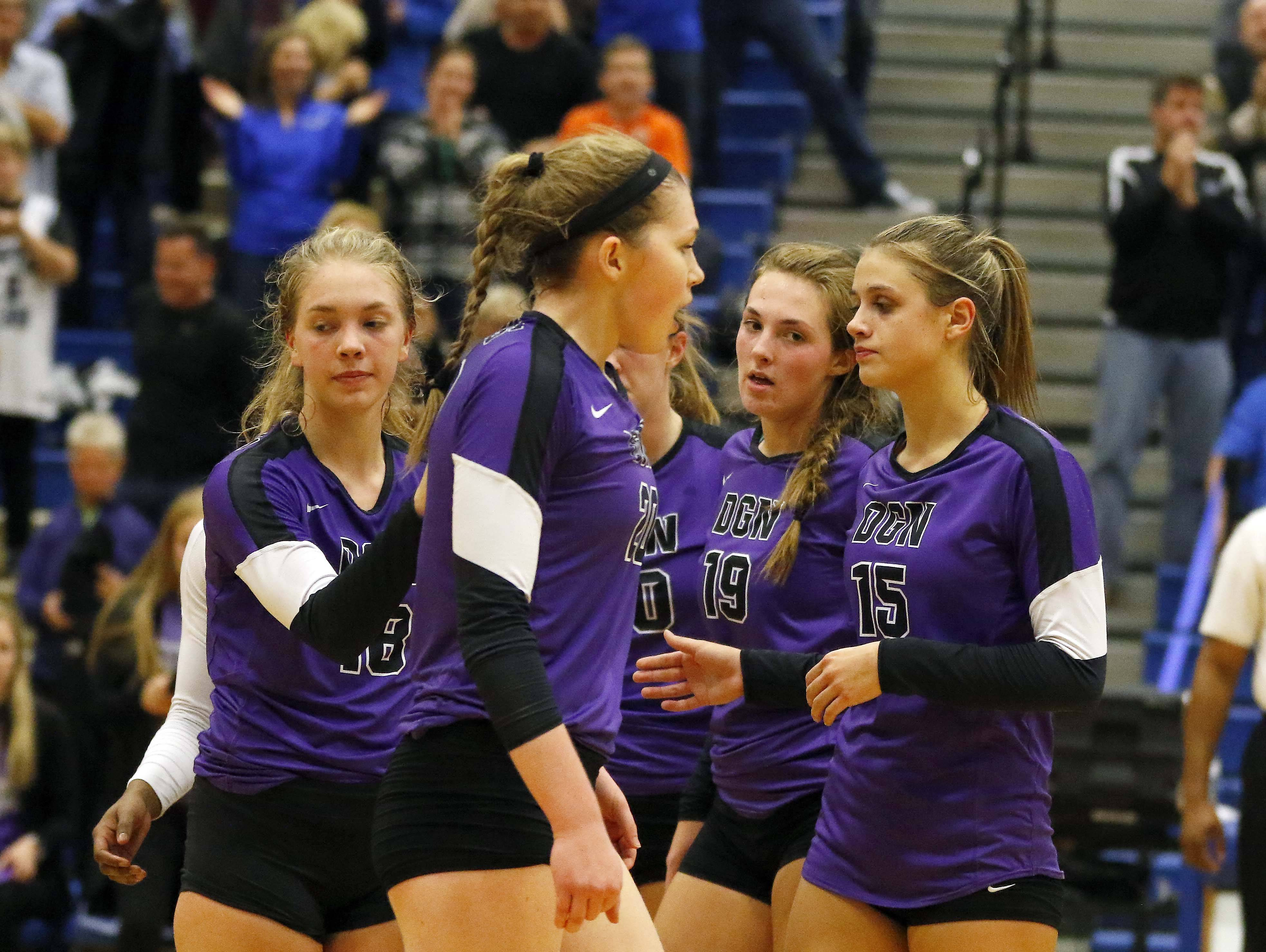 Downers Grove North's reacts after losing to St. Charles North Friday in the Geneva volleyball supersectional.
