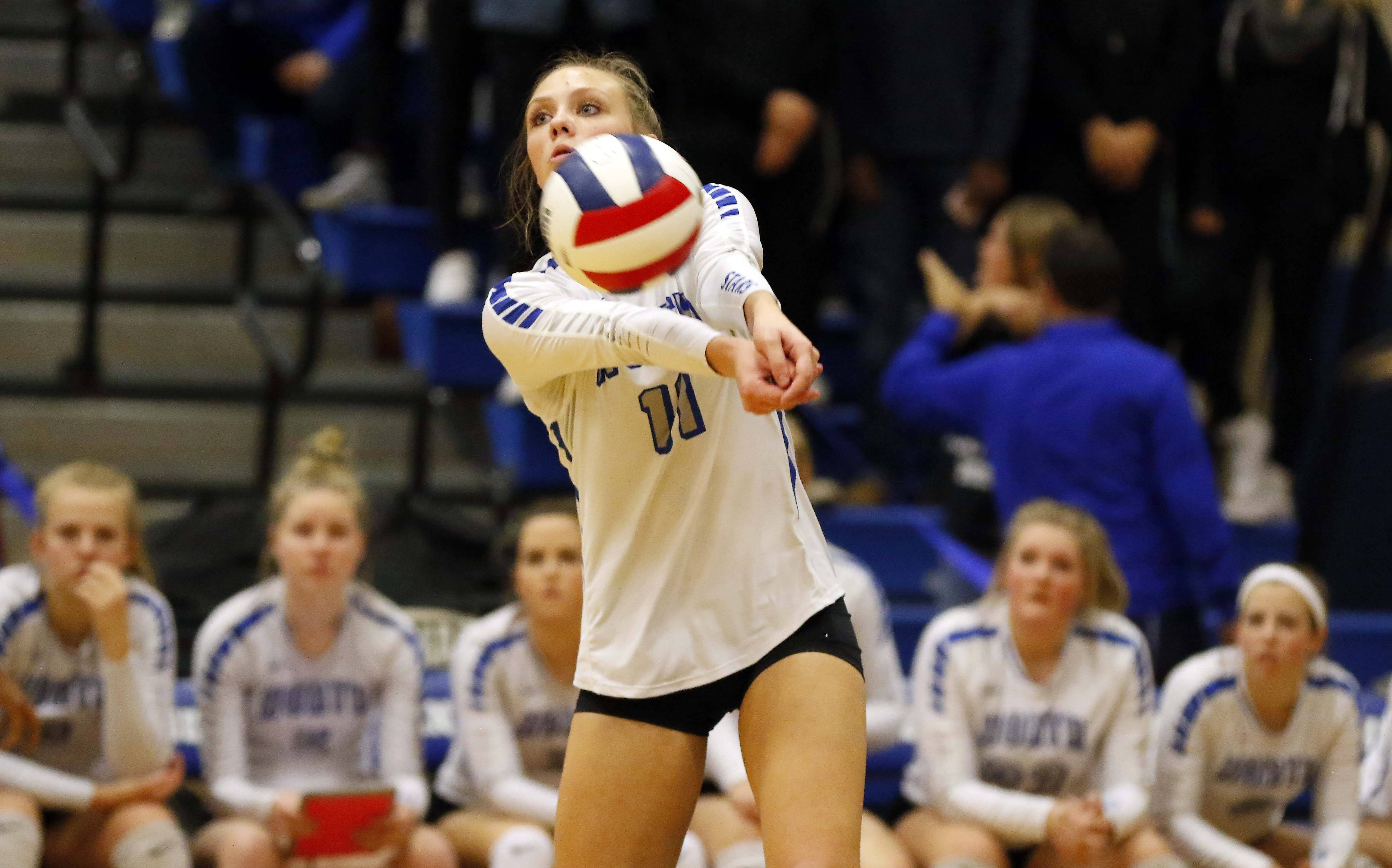 St. Charles North's Katherine Lanz (11) Friday in the Geneva volleyball supersectional.