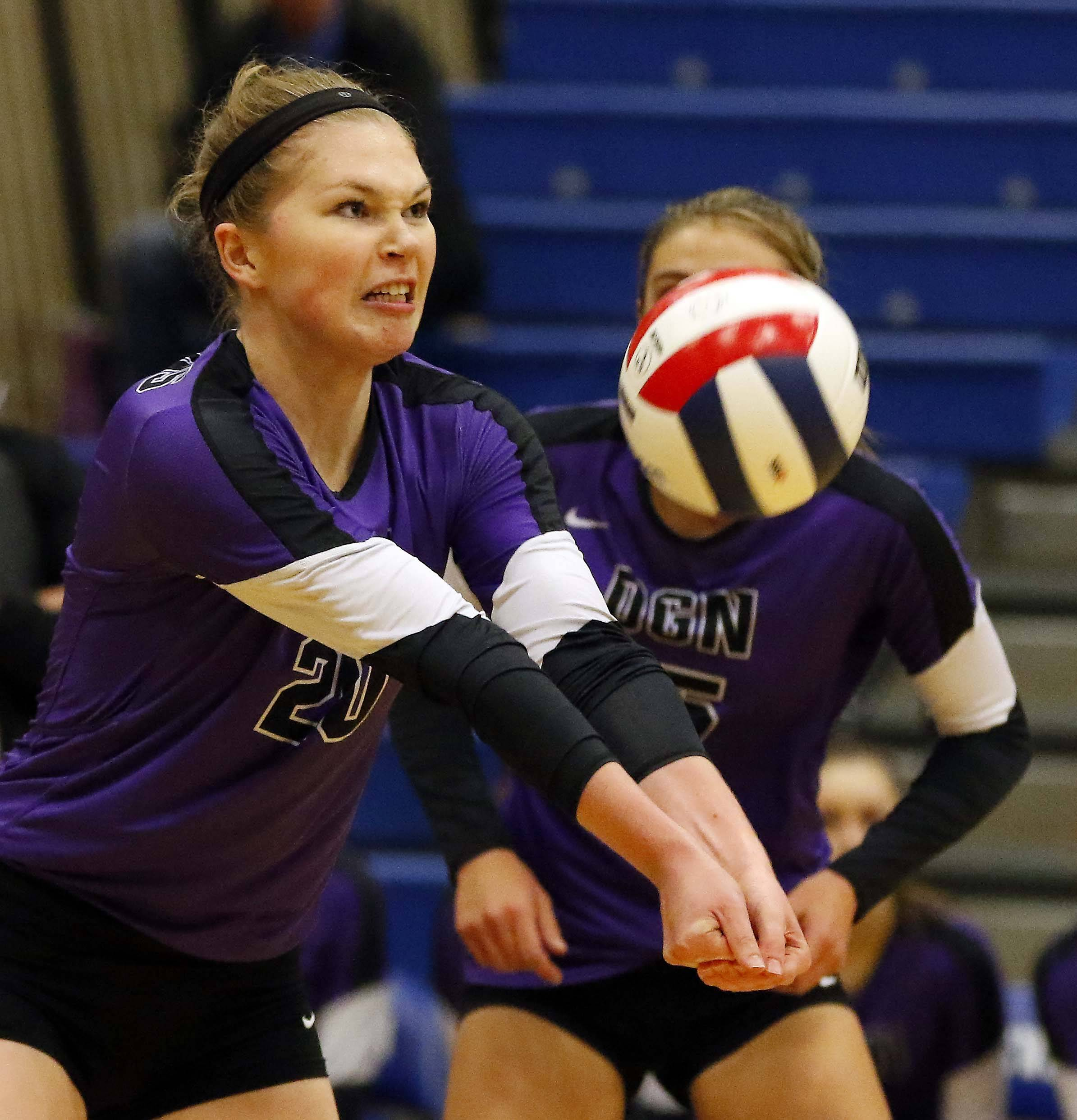 Downers Grove North's Clare Delaplane (20) Friday in the Geneva volleyball supersectional.