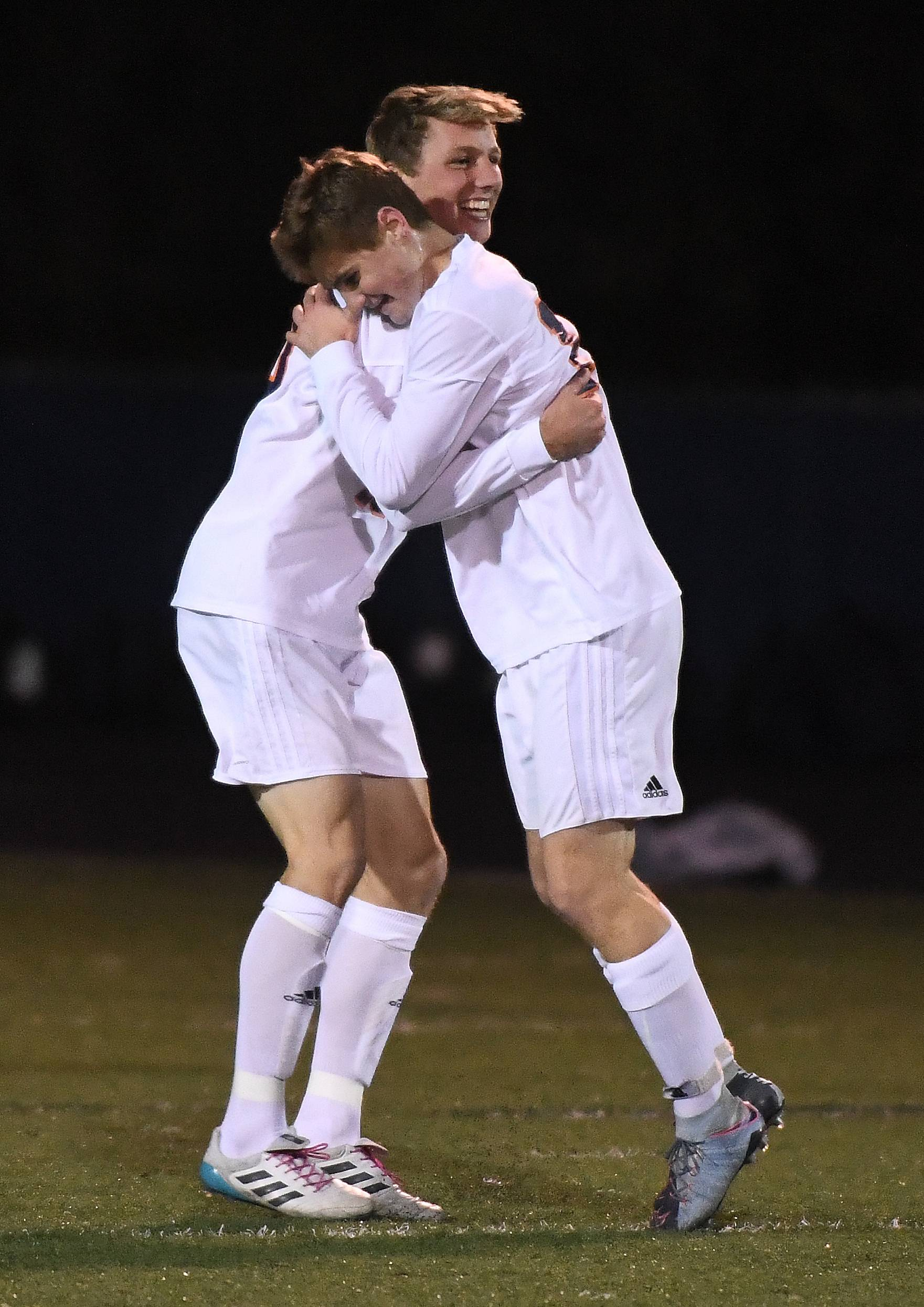 Naperville North's Patrick Koenig scored a first period goal and celebrates with teammate Mitch Konrad.