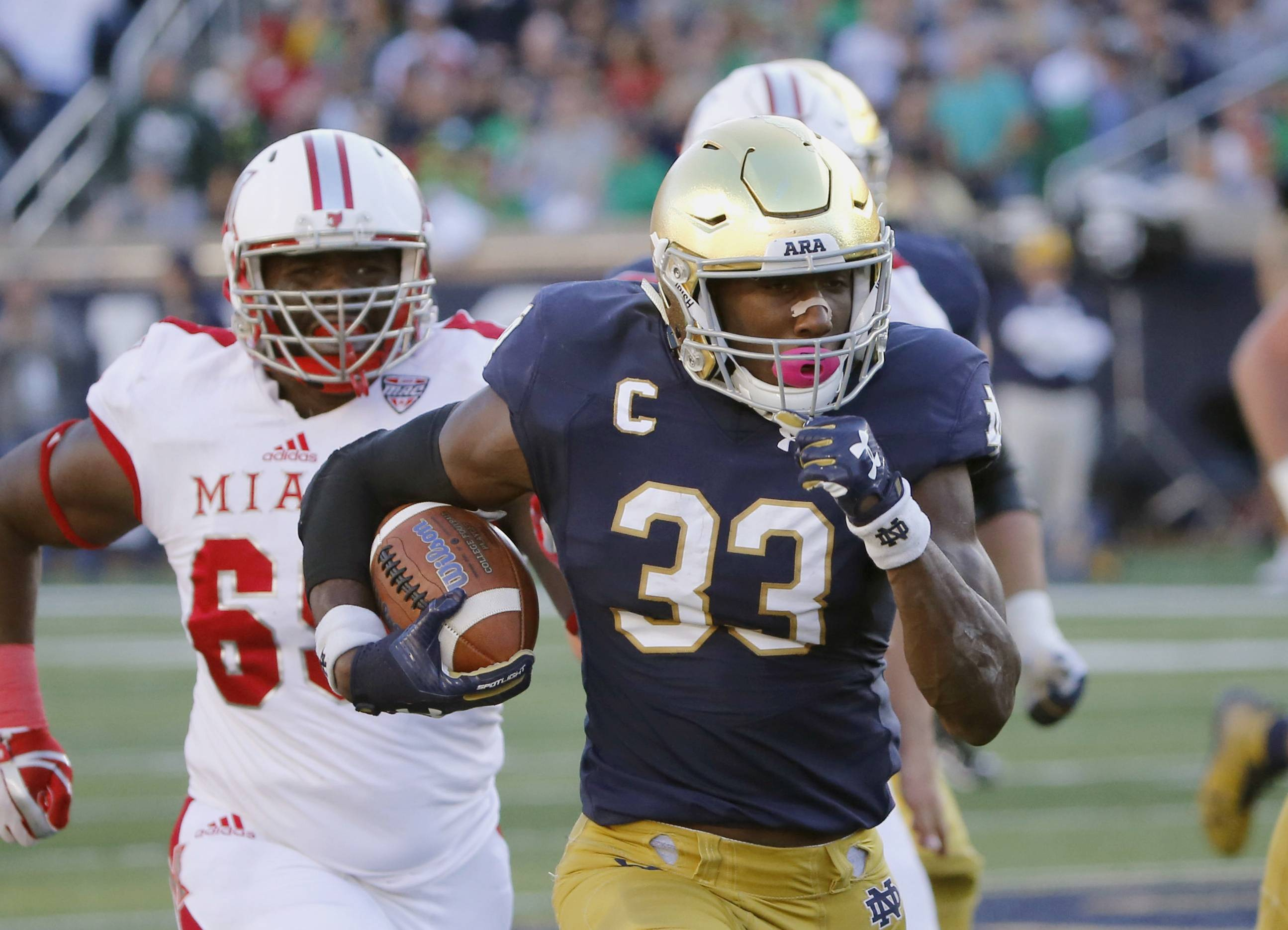 Notre Dame running back Josh Adams heads for the end zone for his second touchdown during the Irish's win over Miami of Ohio. The noise about a playoff bid and the Heisman Trophy is getting louder around No. 5 Notre Dame as it prepares for the visit from Wake Forest on Saturday, Nov. 4. Junior running back Adams, fifth in the nation in rushing with 1,169 yards, has emerged as a legitimate contender for the Heisman and other postseason awards.
