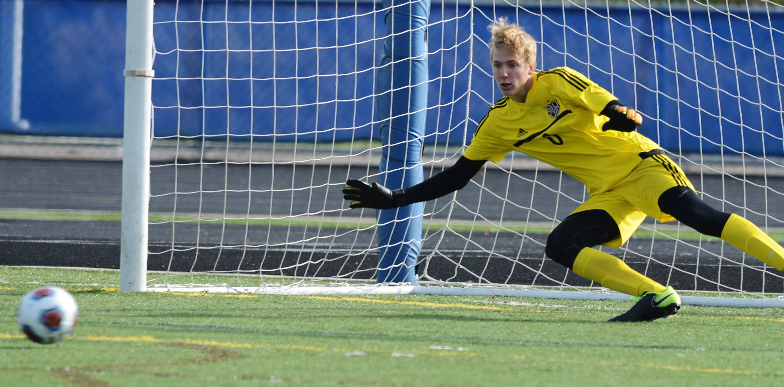 Wheaton Academy goalkeeper J.D. Gunn is unable to stop a Gibault penalty kick during the second half of the Class 2A boys soccer state semifinal in Hoffman Estates Friday.