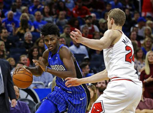 Orlando Magic's Jonathan Isaac, left, moves the ball past Chicago Bulls' Lauri Markkanen during the second half of an NBA basketball game, Friday, Nov. 3, 2017, in Orlando, Fla. Chicago won 105-83. (AP Photo/John Raoux) The Associated Press