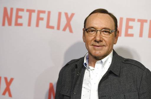 "FILE - In this April 27, 2015 file photo, Kevin Spacey arrives at the Q&A Screening of ""The House Of Cards"" at the Samuel Goldwyn Theater in Beverly Hills, Calif. Netflix says Spacey is out at ""House of Cards"" after a series of allegations of sexual harassment and assault. Netflix says in a statement Friday night, Nov. 3, 2017, that it's cutting all ties with Spacey, and will not be involved with any further production of ""House of Cards"" that includes him. (Photo by Jordan Strauss/Invision/AP, File)"