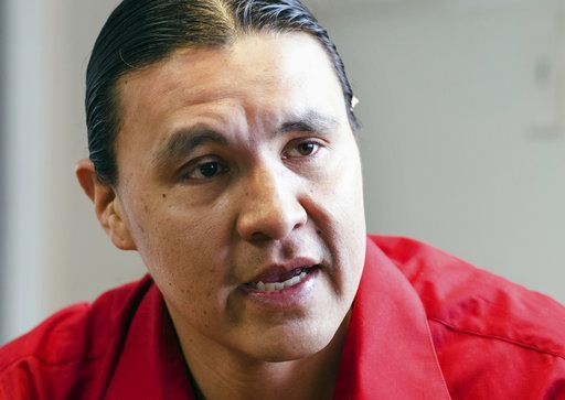 "FILE - In this Feb. 6, 2014, file photo, Chase Iron Eyes, an attorney and American Indian activist on the Standing Rock Reservation, speaks in Fort Yates, N.D. The trial for Iron Eyes, accused of inciting a riot during protests in North Dakota against the Dakota Access pipeline will likely be delayed. Attorneys for Iron Eyes said Friday, Nov. 3, 2017, they want to gather more evidence for their effort to present a ""necessity"" defense, arguing a crime was justified because it prevented a greater harm."