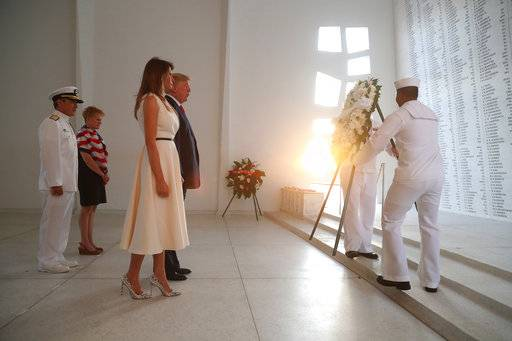 CAPTION ADDITION LOCATION: U.S. President Donald Trump and first lady Melania Trump lay a wreath at the USS Arizona Memorial in Pearl Harbor, Honolulu, Hawaii, Friday, Nov. 3, 2017. Trump begins a five country trip through Asia traveling to Japan, South Korea, China, Vietnam and the Philippines. (AP Photo/Andrew Harnik)