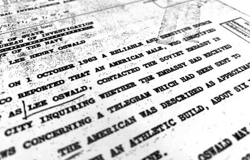 "Part of a file from the CIA, dated Oct. 10, 1963, details ""a reliable and sensitive source in Mexico"" report of Lee Harvey Oswald's contact with the Soviet Union embassy in Mexico City, that was released for the first time on Friday, Nov. 3, 2017, by the National Archives. Documents show U.S. officials scrambling after the assassination of President John F. Kennedy to round up information about Lee Harvey Oswald's trip to Mexico City weeks earlier. (AP Photo/Jon Elswick)"