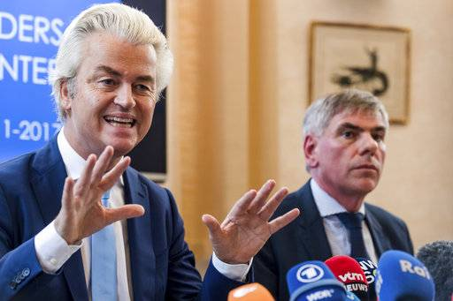 Dutch far-right leader Geert Wilders, left, and Belgian anti-immigrant politician Filip Dewinter address the media at the Belgian federal parliament in Brussels on Friday, Nov. 3, 2017. A Belgian mayor banned Wilders and Dewinter from holding a rally in Molenbeek, a Muslim-majority Brussels neighborhood. (AP Photo/Geert Vanden Wijngaert)