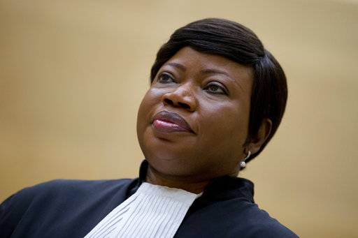 "FILE - In this Tuesday, Sept. 29, 2015 file photo, prosecutor Fatou Bensouda looks on in the court room of the International Criminal Court in The Hague, Netherlands. The chief prosecutor for the International Criminal Court said Friday, Nov. 3, 2017 she is seeking an investigation of alleged war crimes committed in the war in Afghanistan, an unprecedented probe that could encompass United States troops. Prosecutor Fatou Bensouda said in a statement that a preliminary examination found ""a reasonable basis to believe that war crimes and crimes against humanity� were committed in Afghanistan after U.S.-led troops moved in following the Sept. 11, 2001 attacks. (AP Photo/Peter Dejong, file)"