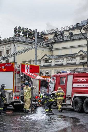 Firefighters extinguish the fire of the building of the Private Collections of the Pushkin State Museum of Fine Arts in Moscow, Russia, Friday, Nov. 3, 2017. Emergency officials say that the fire hasn't hurt anyone and hasn't damaged any art works. (AP Photo/Alexander Zemlianichenko)